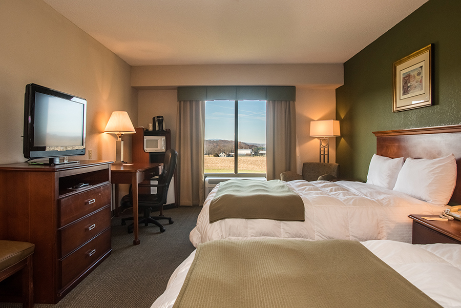 room with two queen beds at Round Hill Inn Orange Virginia